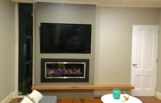 Brighton East wall heater, TV & Timber feature beam